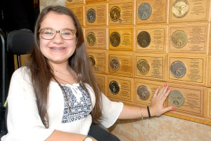 Leigh Dittman has a gold plaque on the philanthropic wall at Shriners Hospitals for Children, signifying that she's responsible for raising $1 million in donations. (Courtesy of Shriners Hospitals for Children)