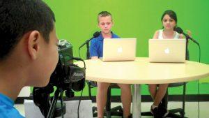 Gadiel Ramirez records the sportscast featuring Jack Carbone as Jack Woodchuck, and Alyssa Bollent as Alyssa Leaf. (Photos courtesy of Veterans Elementary School)