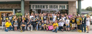 Members of the Bay Area Black and Gold Club pose for a group picture outside O'Brien's Irish Pub in Tampa (Courtesy of Doug DeFelice)