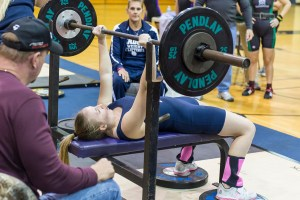 Senior Maggie Hull gets ready for a bench press rep at the district meet in River Ridge on Jan. 13.