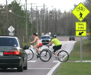 Bicyclists can stop the traffic by using a crosswalk signal, where the trail crosses busy roadways.