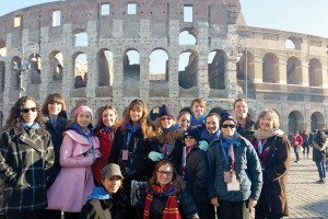 This shot, of the entire choir, was taken near the Coliseum, in Rome.Top, from left: Blaise Carson, Sarah Balling, Valeria Merkt, Clare Hernandez, Claudia Vitale, Catherine Beard, Maria Hernandez, Emily Balling, Tierra Carson and Esteban Merkt. Middle, from left: Michael Beard, Donnie Beard and Sandra Lau. Bottom: Lexi Rosario and Adriana Schiereck. (Courtesy of Jackie Rosario)