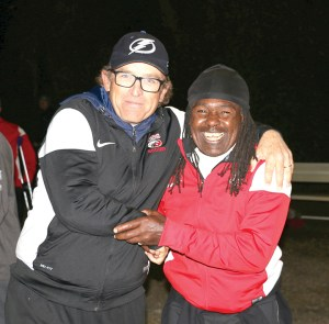 Carrollwood boys varsity head coach Jim Harte (left) pictured with the team's trainer, Dudu. (Courtesy of Denise Pironti)