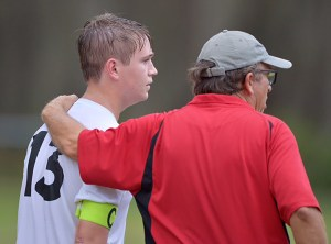 Spencer Peek gets some instruction during a game from Jim Harte, head soccer coach at Carrollwood Day School.