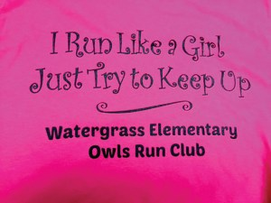 """Through business donations, the club was able to create a pink T-shirt that says, """"I Run Like a Girl, Just Try to Keep Up."""""""