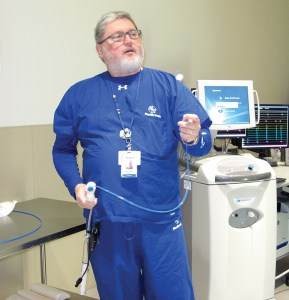 Michael Baird, from Medtronic, is holding a cryoballoon, used for freezing during an AFib ablation.
