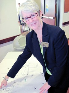 Dr. Bonnie Clark, vice president of distance education and provost of Pasco-Hernando State College's Porter Campus at Wiregrass Ranch, checks out a map of early Wesley Chapel homesteads. (B.C. Manion/Staff Photo)