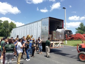 (Kevin Weiss/Staff Photo) Students gather to see pallets full of bottle caps loaded onto a 53-foot truck that will send them to a recycling center in Kentucky. They have been collecting caps since August.