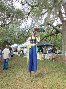 Lots of people did a double take when they saw Amanda Renaud, of Topsy Turvy — an entertainment troupe — towering above them on stilts at the 2015 EcoFest at Lowry Park. (File Photos)