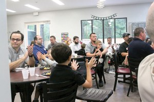 Fifteen fathers attended the Lutz Learning Center's first All-Pro Dad Chapter meeting on May 18. The program uses football themes to tout the importance of being a good father.