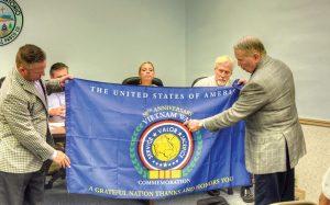San Antonio Mayor Tim Newlon, left, and Brig. Gen Thomas V. Draude display the flag. (Courtesy of Richard K. Riley)