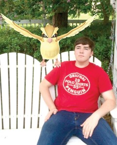 Chris Jackson and Pidgey, a Pokémon Go creature, loosed in our three-dimensional world. (Courtesy of Tom Jackson)