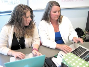 Kristen Fuqua and Alyse Buckalew, teachers at Pine View Middle School, both took part in the Teacher Technology Summer Institute at Saint Leo University. The institute aims to help teachers harness the power of technology in their classrooms. (B.C. Manion/Staff Photo)