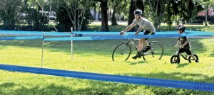 With his dad, Josh Thornton of Dade City in the lead, 5-year-old Bentley Thornton keeps up the pace riding his 'Strider' bicycle while dad rides through on his carbon-fiber, multi-gear bicycle.