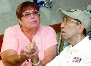 The heartfelt event brought tears to the eyes of Karen Burgos, of Spring Hill, as she holds hands with nursing home resident Henry Burgos Jr. He was a paratrooper with the U.S. Army while serving in Korea.