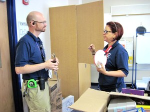 Principal Steve Williams and teacher Maria Pita chat, while the teacher sets up her new classroom at Wiregrass Elementary School.