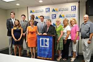 U.S. Rep. Kathy Castor, wearing an orange dress, along with student leaders and members of the Greater Tampa Association of REALTORS, held a press conference to highlight problem of student loan debt. (Courtesy of the office of U.S. Rep. Kathy Castor)