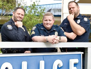These members of the Zephyrhills Police Force are growing whiskers for a good cause. They are, from left, Capt. Derek Brewer, Sgt. Nathan Gardner and Officer Caleb Rice. They are standing outside of the Zephyrhills Police Department Headquarters. (Tom Jackson/Photo)