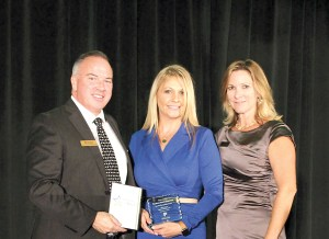 Shauna McKinnon, center, of Bayfront Health Dade City, accepts a special recognition award during the 30th annual Banquet and Industry of the Year Awards presented by Pasco Economic Development Council. Bill Cronin is to her left and Barbara Wilhite is to her right. (Photos courtesy of Pasco Economic Development Council)