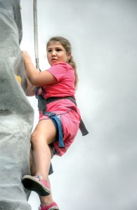 Richard K. Riley/Photos Taylor Weiss, of New Port Richey, makes her way up the rock wall.