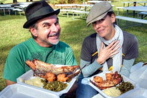 Mark and Jenny Hanna, of Dade City, are impressed with the generous portions served at the Mullet & Music Festival (Richard K. Riley/Photos)