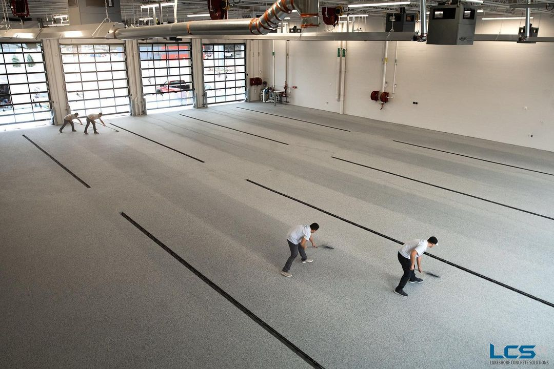 Four flooring contractors installing flooring solutions at a West Michigan commercial business