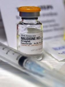 bottle and syringe of medication