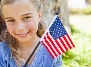 a girl with an american flag