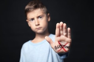 boy holding hand against bullying