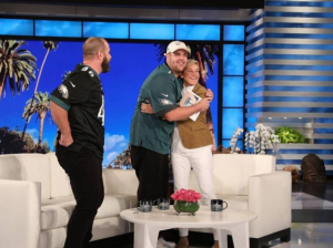 eagles fan diagnosed with autism hugging ellen