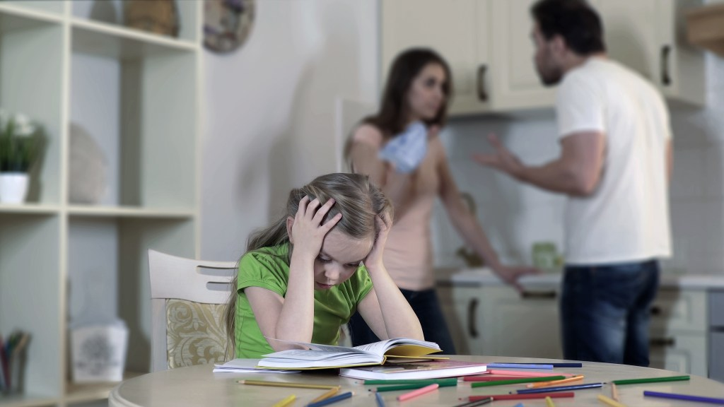 Upset child listening to parents fighting/suffering, family conflict