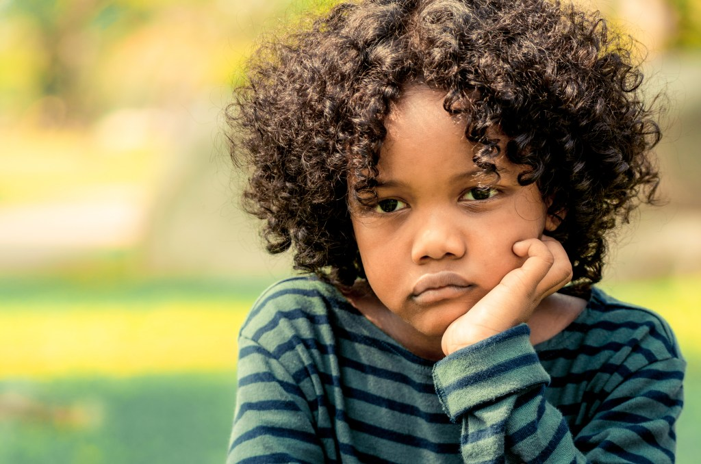 Sad little african american kid, troubled