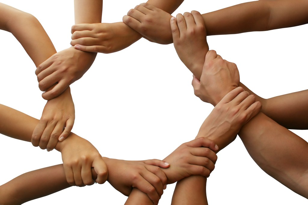 hands all joined together to create a circle