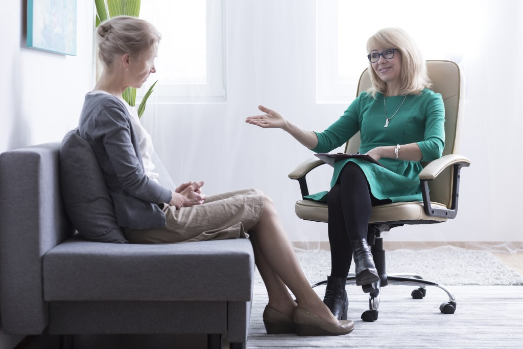 counseling mature woman getting mental health support from friendly female psychiatrist
