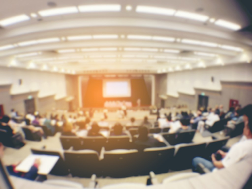 blurred image of Business Conference and Presentation.