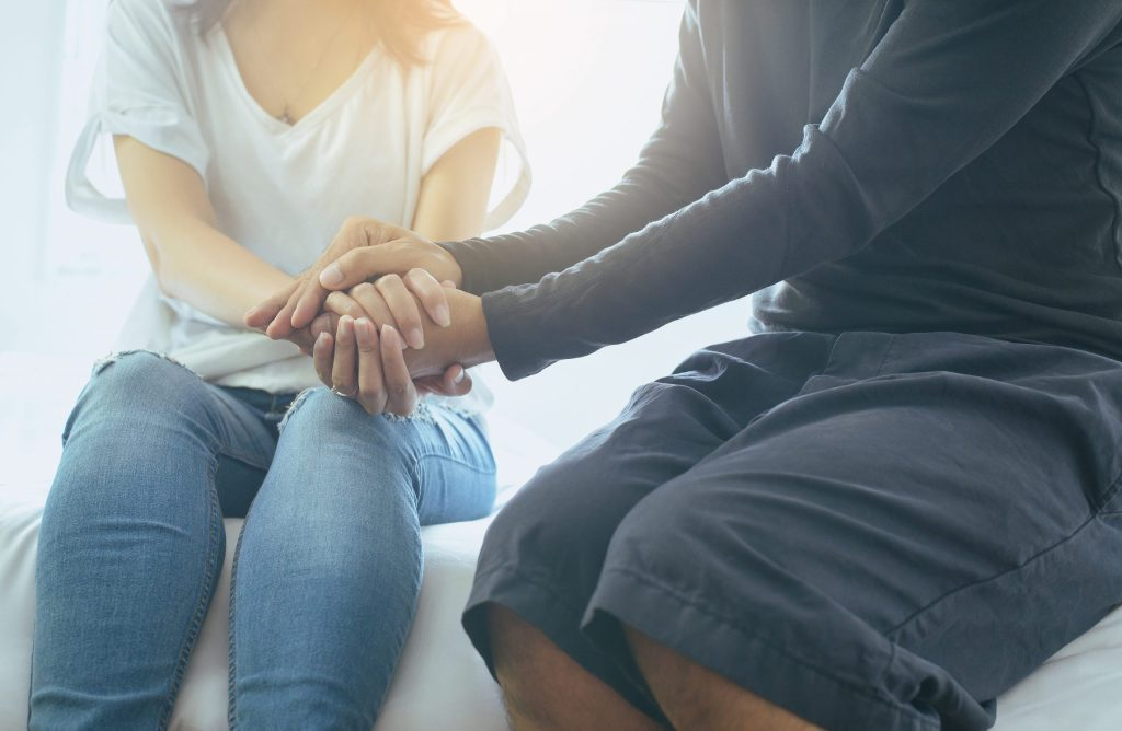 Man giving hand to depressed woman,Mental health care concept