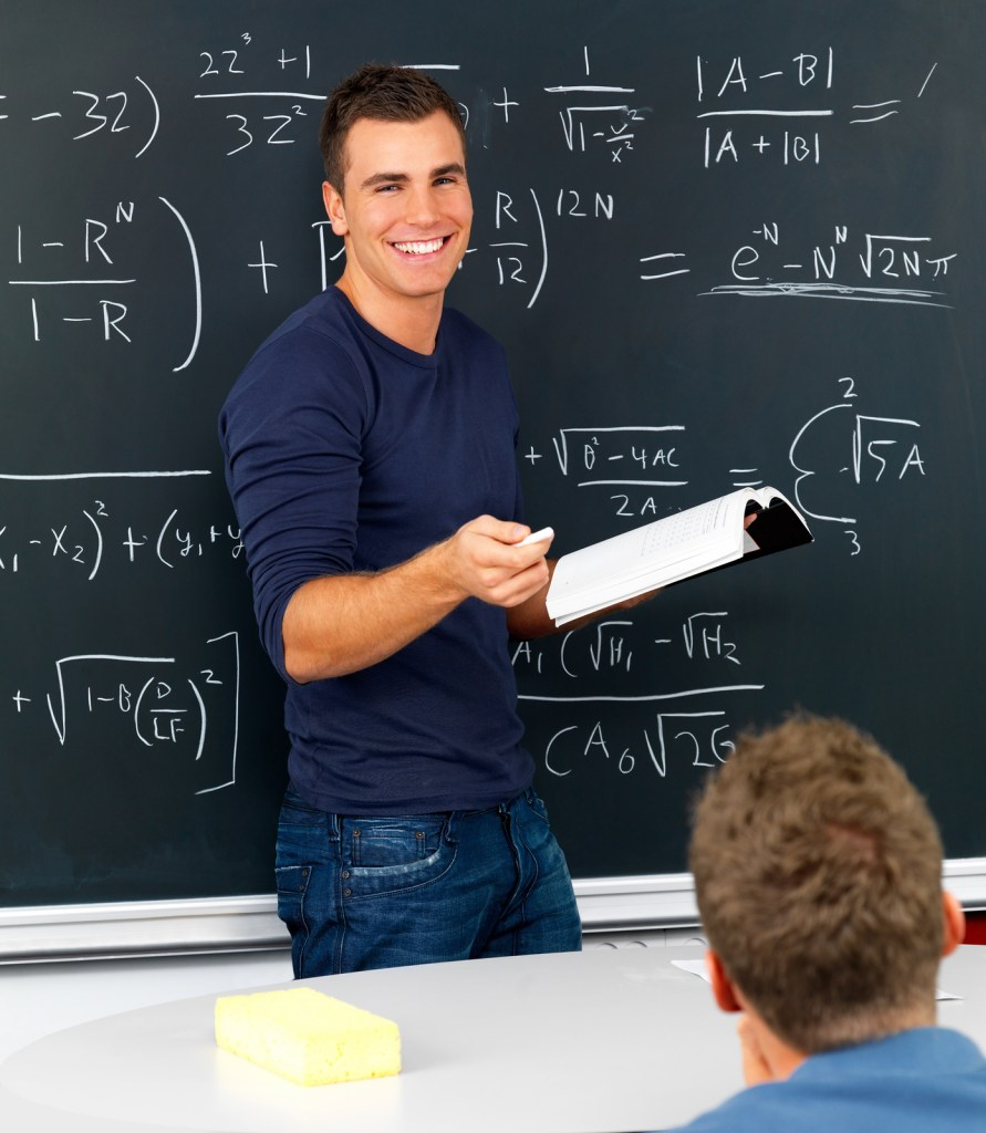 Male teacher teaching math to students.