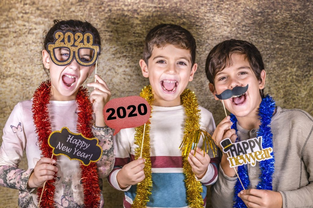 Three cute kids celebrating New Years 2020