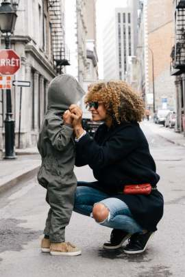 Mom with young boy on city street