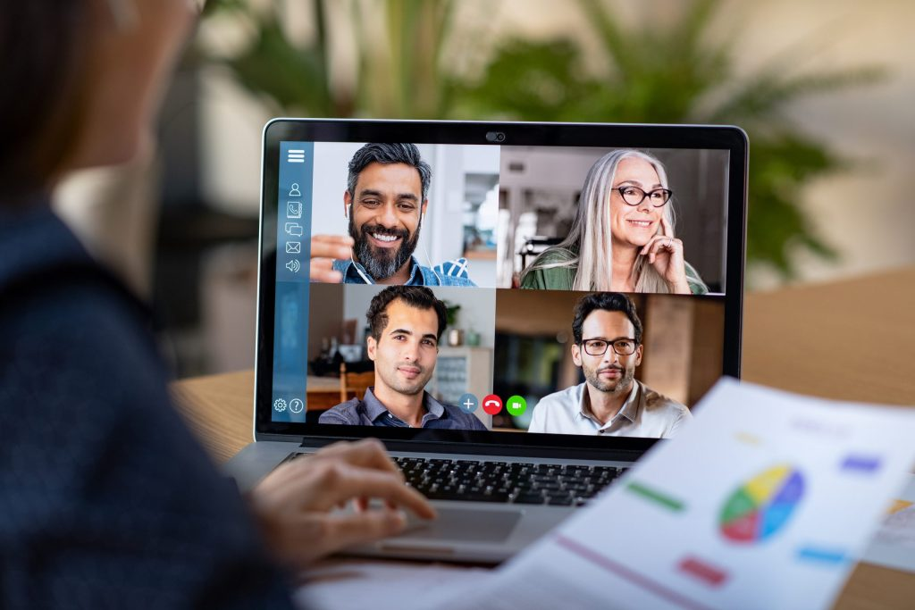 Person working from home talking to her colleagues about plan in video conference. Group of people smart working from home