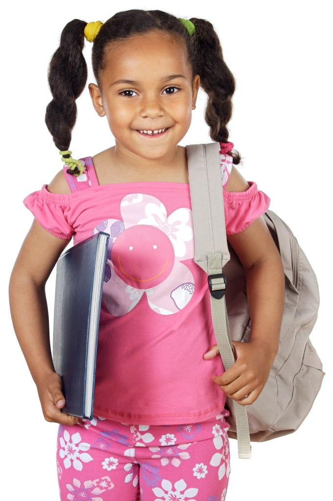 Black little girl carrying notebook and school bag