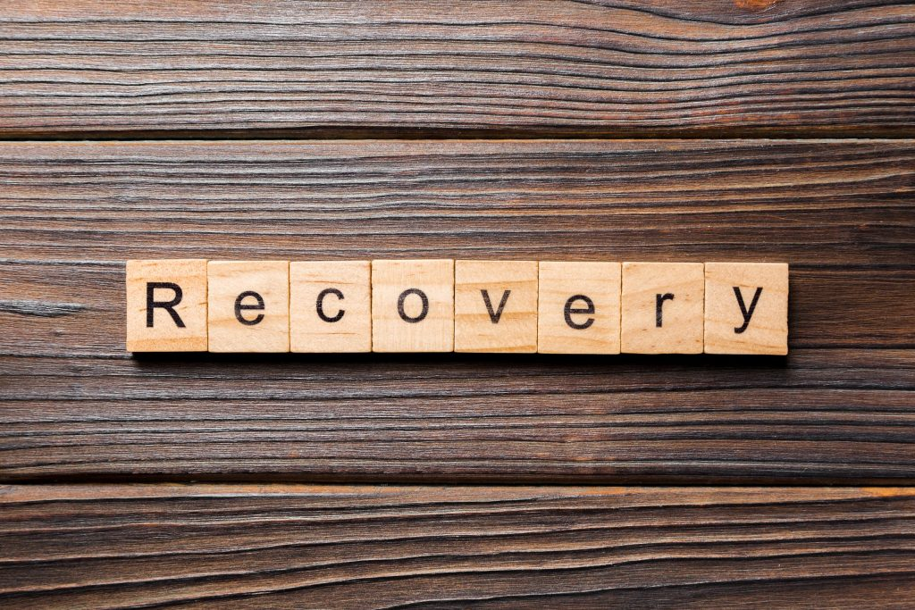 recovery word written on wood block