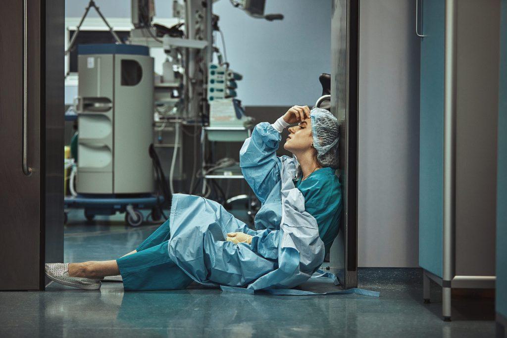 Woman surgeon with fatigue stress depression unhappy, medicine healthcare emotions