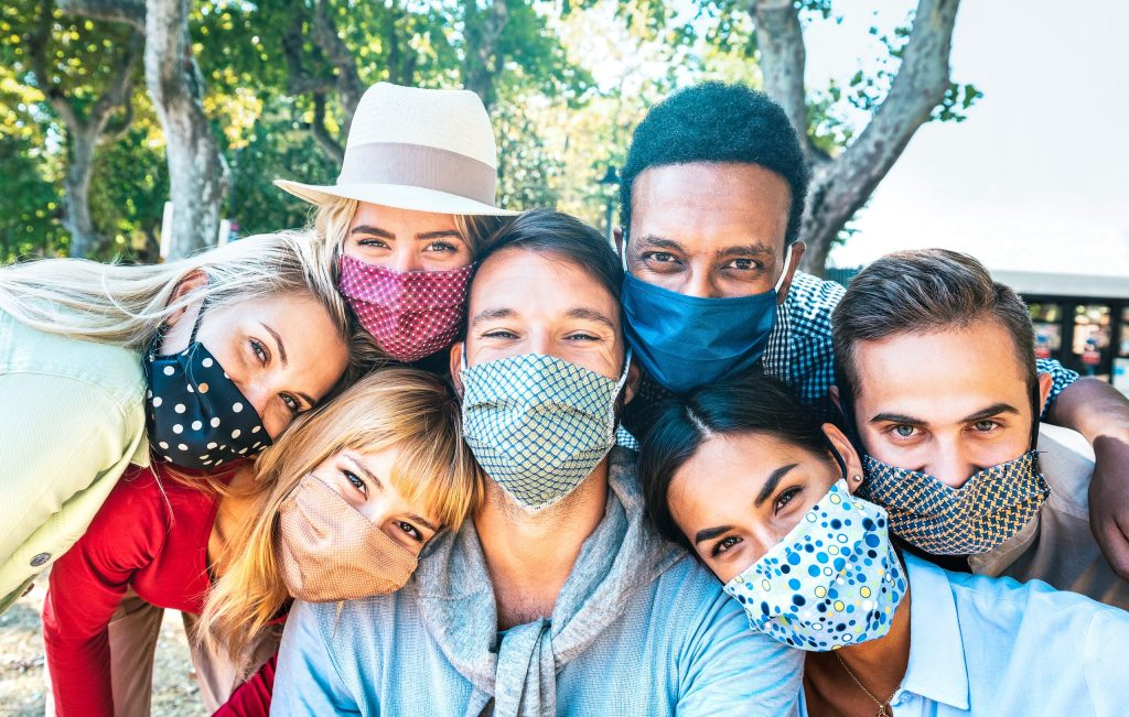 Multiracial teens with closed face masks during Covid, New normal lifestyle concept