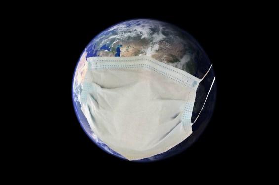 Coronavirus. Covid-19. Coronavirus Pandemic. Earth wears a Paper Face Mask to protect itself from the Coronavirus Pandemic.