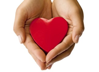 hands cupped around a red heart.