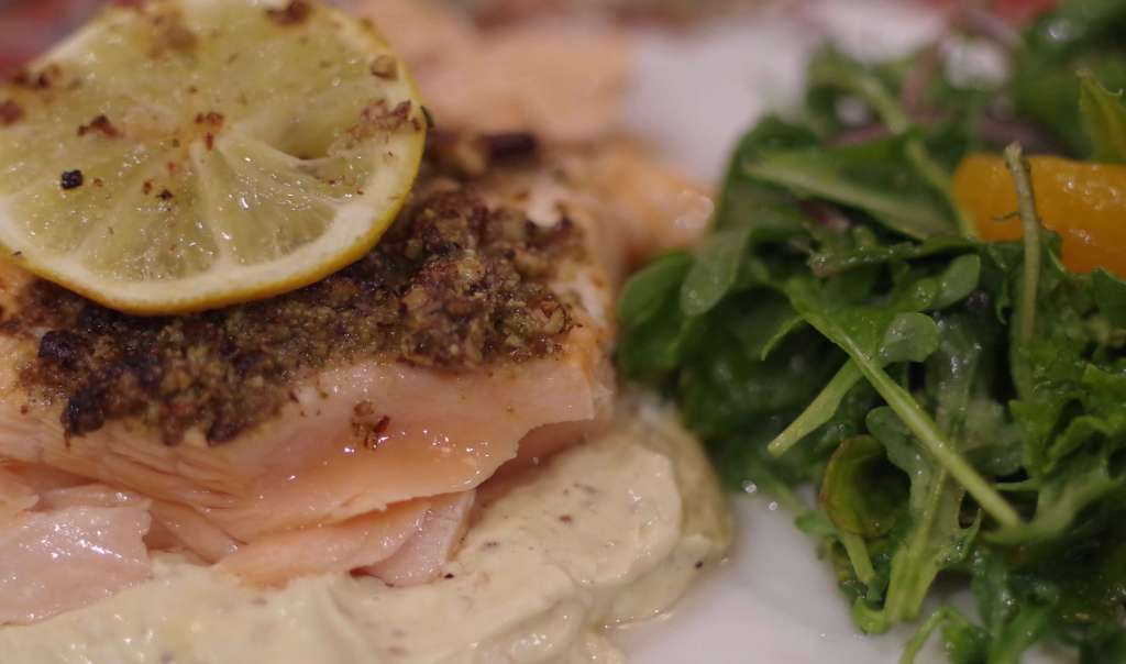 Pecan crusted salmon over mustard sauce with arugula orange salad. Inspired by Frazer's Restaurant St. Louis, MO.