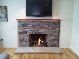 Custom ledge stone veneer with New Hampshire granite hearth - NH Chimney Sweep