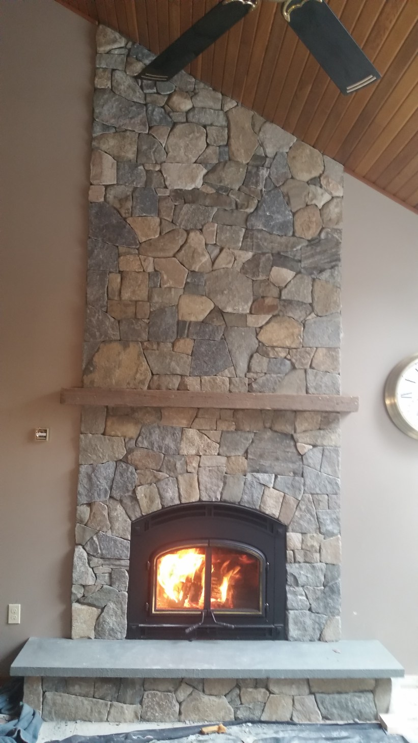 wood burning fireplace with natural stone