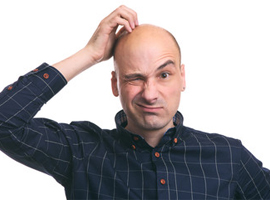 Bald man scratching his head